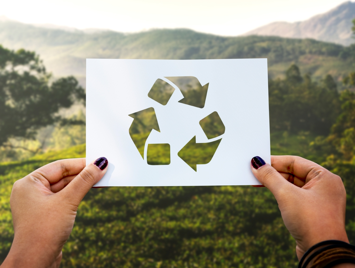 stock paper displaying recycling sign to showcase die cut features