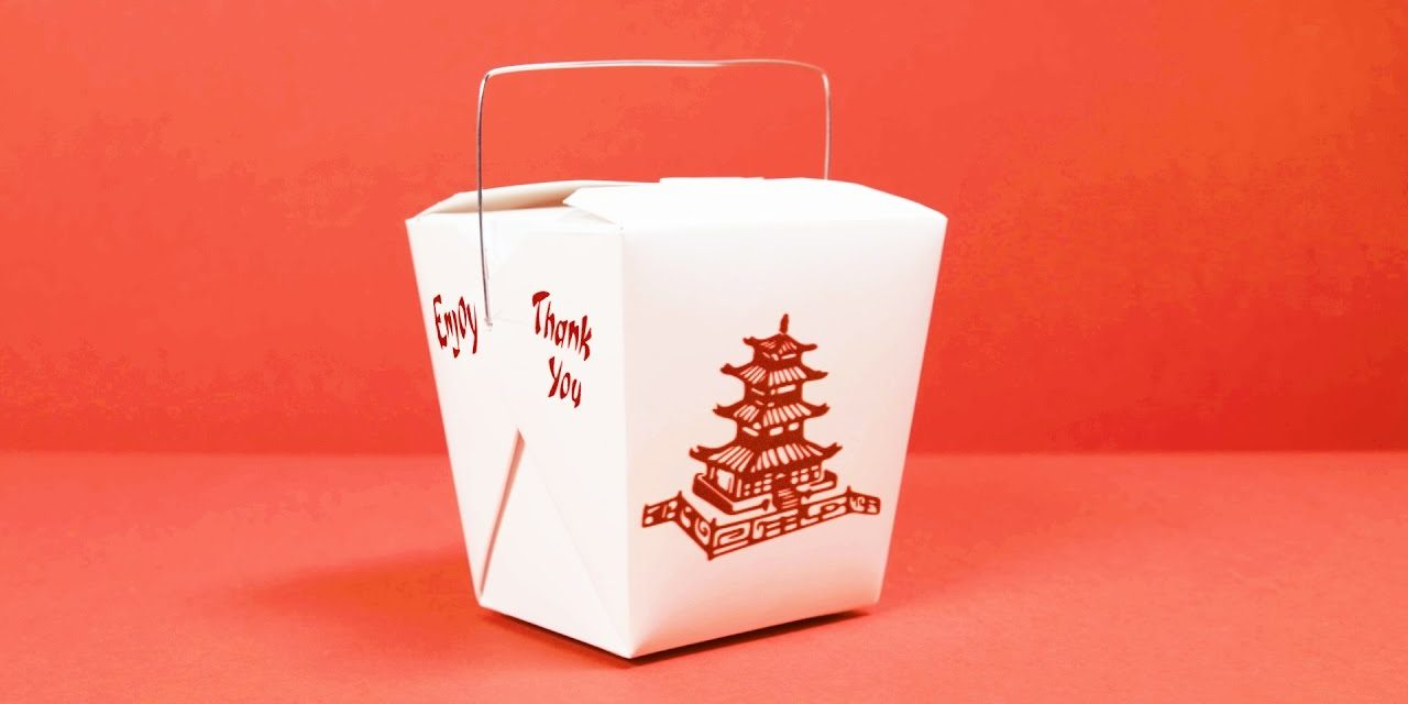 A white Chinese takeout box featuring a red pagoda and red text, placed on a red background.